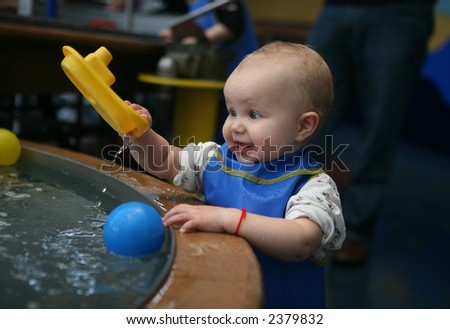 baby play with water - stock photo