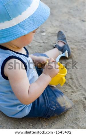 Baby playing - stock photo