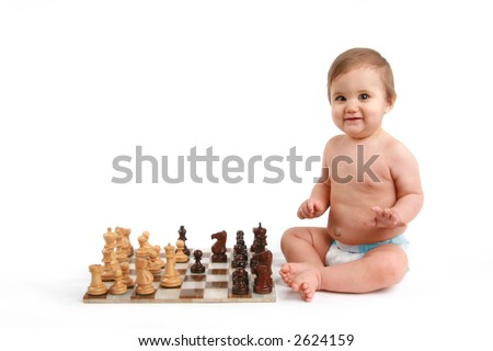 baby playing chess - stock photo