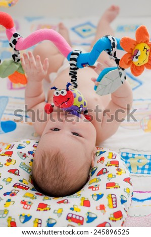 baby playing in a crib - stock photo