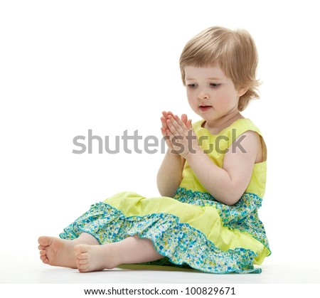Baby playing sitting on the floor on white background