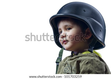 Baby playing war with military helmet - stock photo