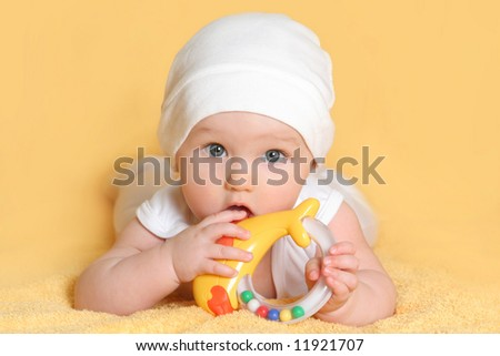baby playing with a toy (girl 6 month) - stock photo