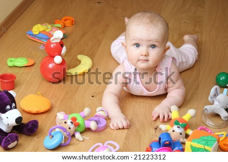 baby playing with a toys - stock photo