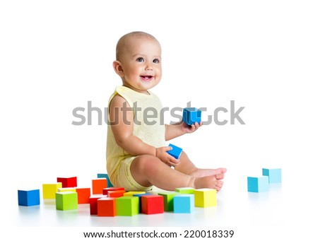 baby playing with building block toys - stock photo