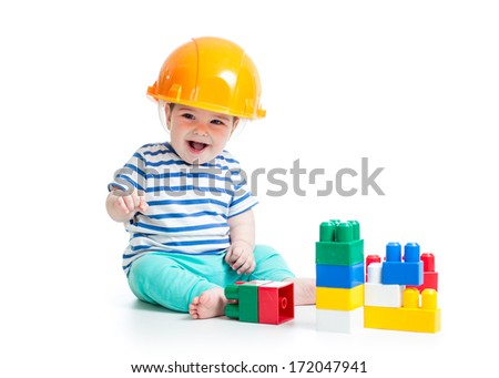 baby playing with building blocks toys - stock photo