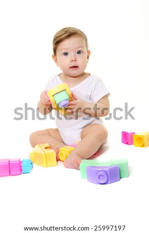 Baby playing with colored blocks - stock photo