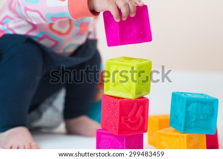 baby playing with colored cubes isolated on the white background - stock photo