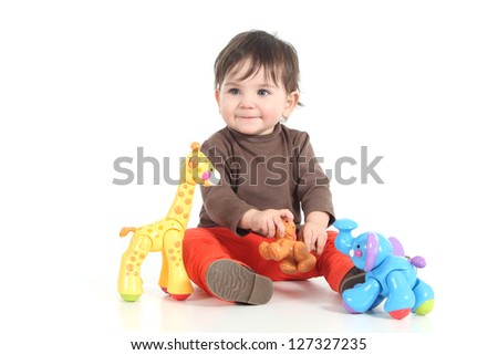 Baby playing with colorful animal toys on a white isolated background - stock photo