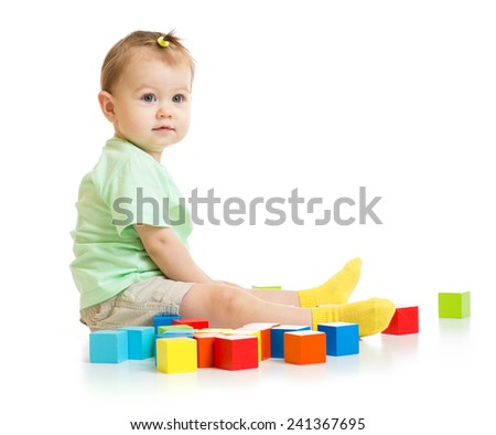 baby playing with colorful blocks isolated on white - stock photo