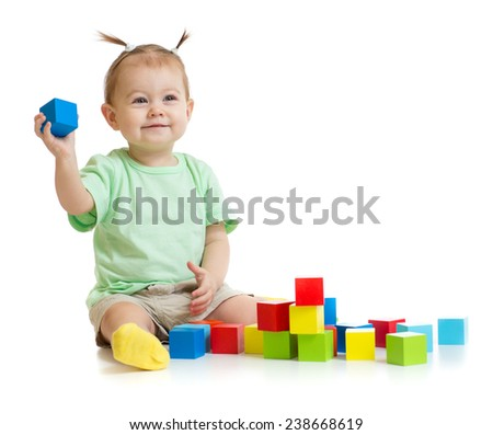baby playing with colorful building blocks isolated - stock photo