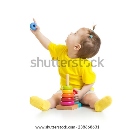 baby playing with colorful toy and looking up isolated - stock photo