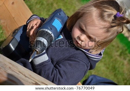 baby playing with Cordless Screwdriver - stock photo