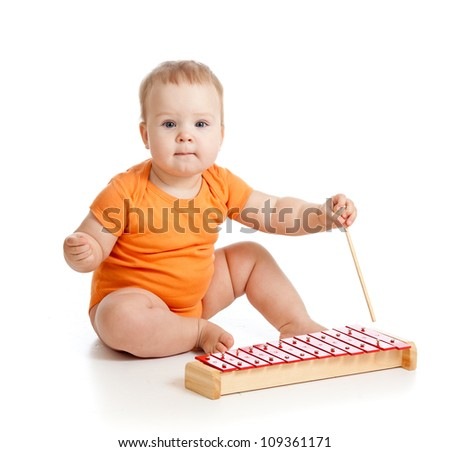 baby playing with musical toy - stock photo