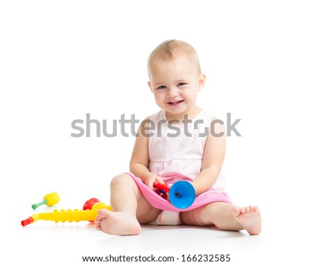 baby playing with musical toys isolated on white background - stock photo