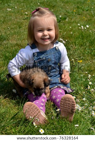 baby playing with puppy - stock photo