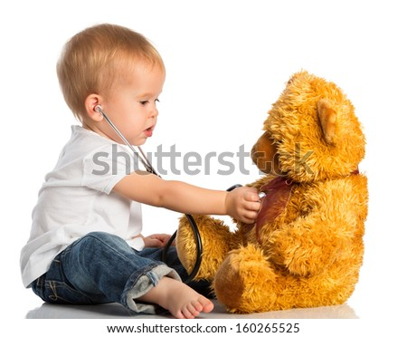 baby plays in doctor toy bear and stethoscope - stock photo