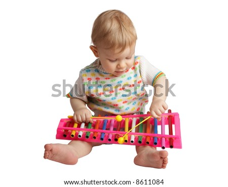 baby plays with a musical toy - stock photo