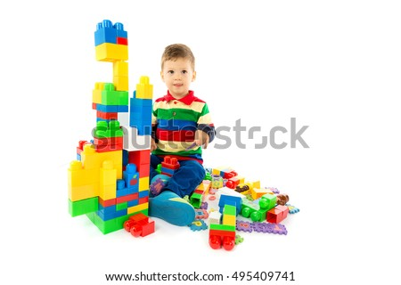 baby plays with blocks