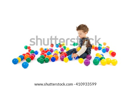 baby plays with color balls