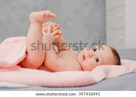 Baby plays with her legs