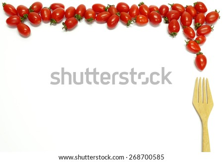 Baby plum tomatoes and fork isolated on white background - stock photo