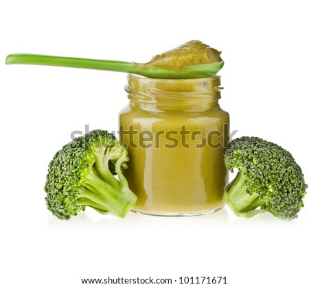 baby puree of broccoli cabbage with spoon on white background - stock photo