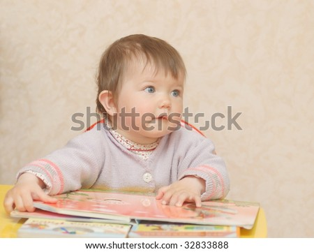 Baby , reading the book - stock photo