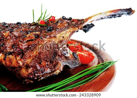 baby ribs served on wood over white - stock photo