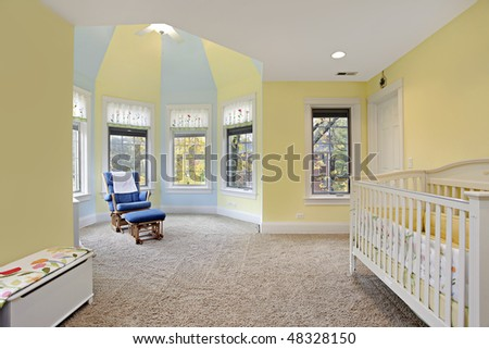 Baby's bedroom with yellow and blue walls - stock photo