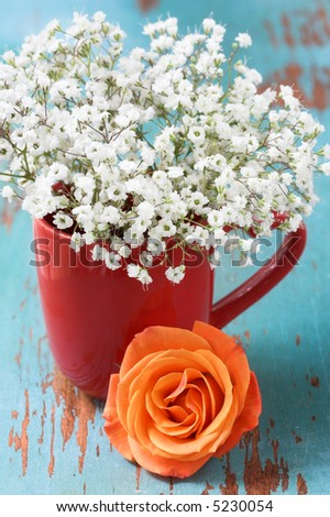 Baby's breath flowers with rose - stock photo
