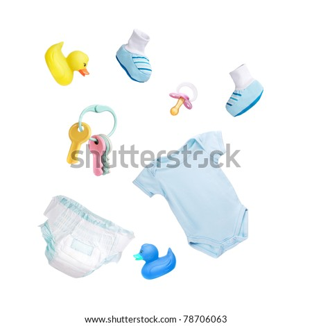 Baby's clothes and toys isolated on white - stock photo