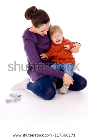 baby's crying, tantrums on the hands of mother isolated on white background - stock photo