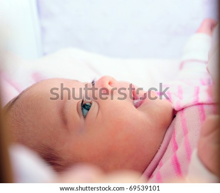 baby's curiosity and happiness.  Profile image of happy baby girl with a curiosity expression on her face. - stock photo
