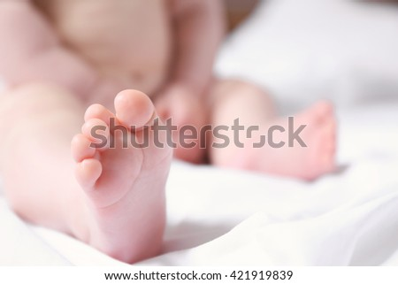 Baby's feet on the blanket, close up - stock photo