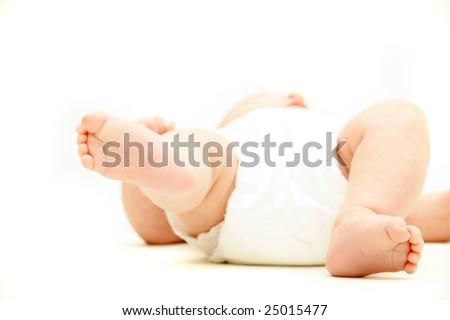 baby's feet over white - stock photo