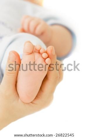 baby's foot in parent's hand - stock photo