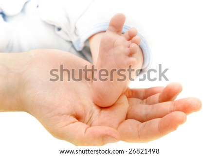 baby's foot on parents' hand - stock photo