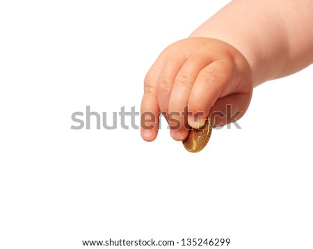 Baby's hand and coin isolated over white. - stock photo