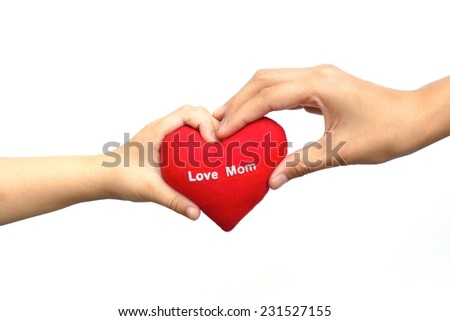 baby's hand giving a red heart with a word love mom to his mother - happy mother's day - stock photo