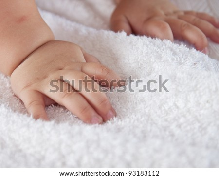 baby's hands on the towel - stock photo