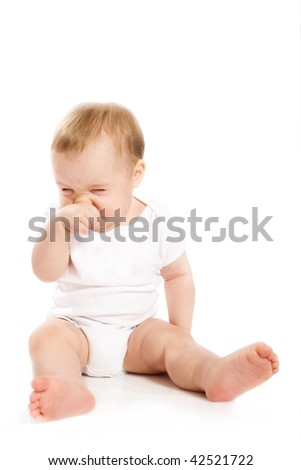 Baby's scratching his nose - stock photo