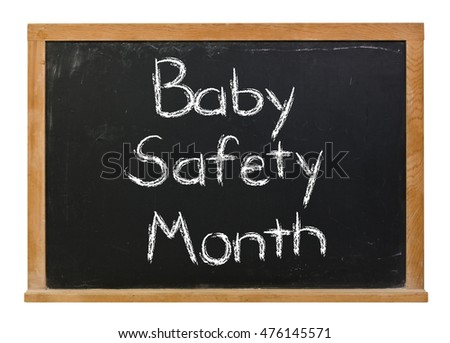 Baby Safety Month written in white chalk on a black chalkboard isolated on white