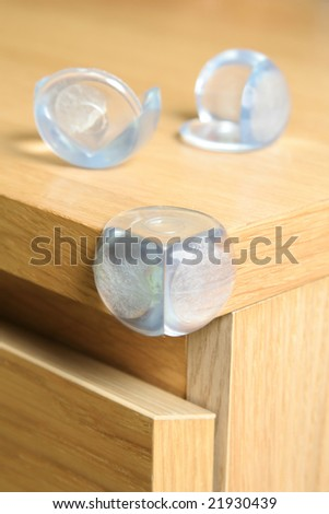 baby safety on the acute angle furniture - stock photo