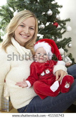 baby santa claus with young mother