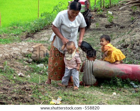 Baby & Saucepan.   Myanmar (Burma) - stock photo