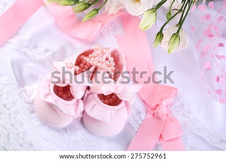 Baby shoe and cross for Christening - stock photo
