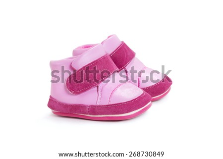baby shoes on a white background - stock photo