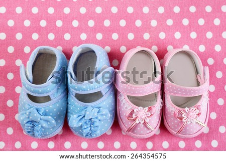 Baby shoes on cloth background - stock photo