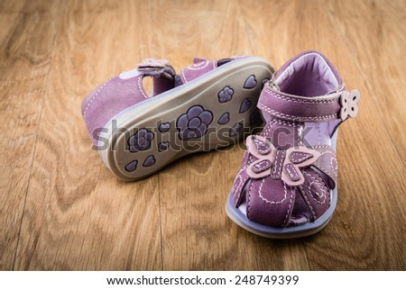 baby shoes on wooden background - stock photo